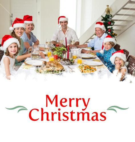 Composite image of happy family in santa hats having christmas meal