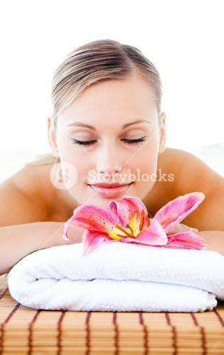 Portrait of a relaxed young woman lying on a massage table
