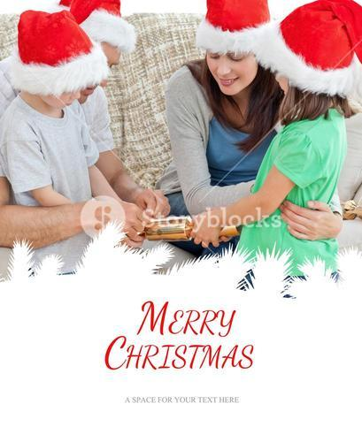 Composite image of family opening crackers together on the sofa