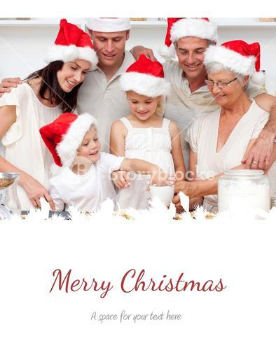 Composite image of family baking christmas cakes and sweets in the kitchen
