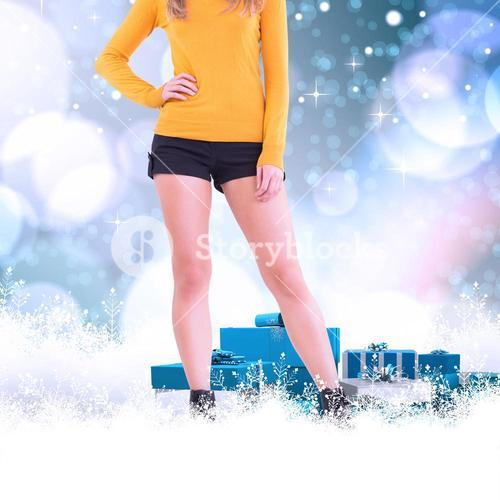 Composite image of lower half of woman in boots and shorts