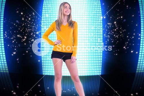 Composite image of stylish blonde smiling with hand on hip