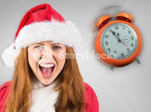 Composite image of festive redhead shouting at camera