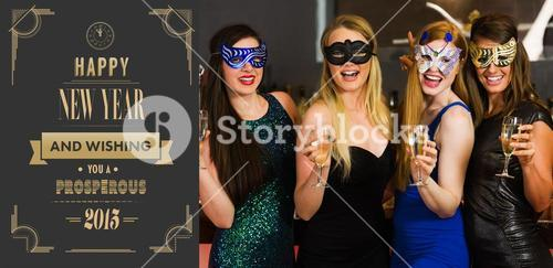 Composite image of laughing friends wearing masks holding champagne glasses