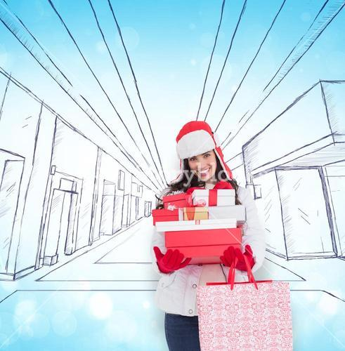 Composite image of brunette in winter clothes holding many gifts and shopping bags