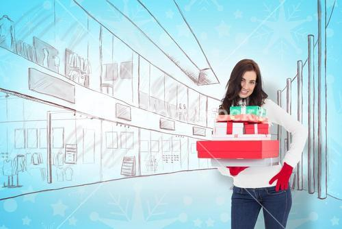 Composite image of pretty brunette posing and holding pile of gifts