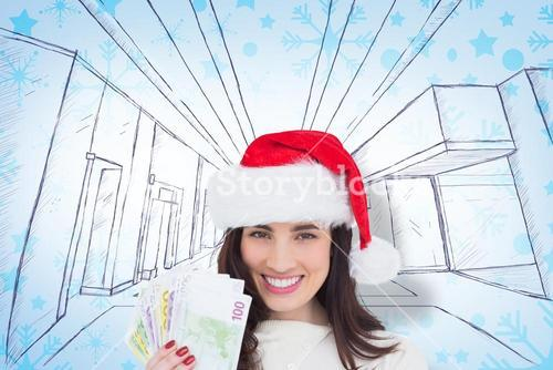 Composite image of happy brunette holding her cash