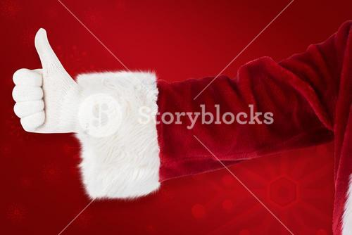 Composite image of father christmas gives a thumb up