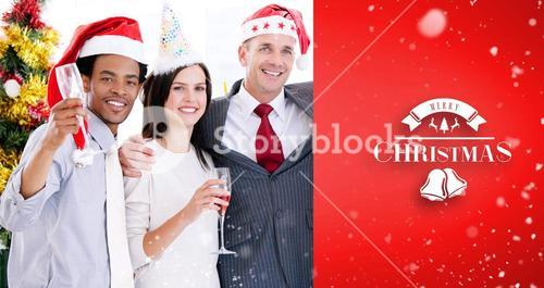 Composite image of united business team drinking champagne to celebrate christmas