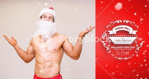 Composite image of portrait of shirtless macho man with fake santa beard