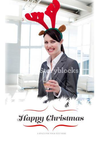 Composite image of smiling businesswoman with a novelty christmas hat toasting with champagne