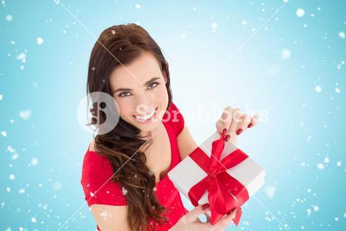 Composite image of happy brown hair opening gift