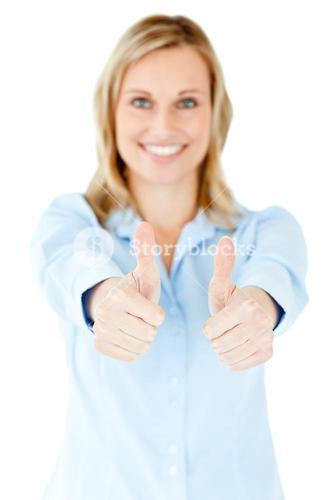 Radiant businesswoman smiling at the camera with thumbs up