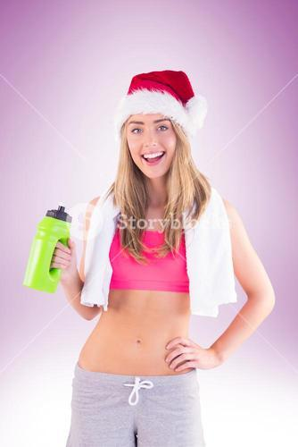 Festive fit blonde smiling at camera