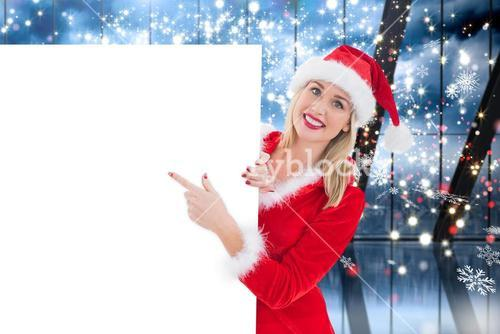 Composite image of festive blonde showing white card