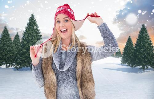 Composite image of blonde in winter clothes smiling at camera