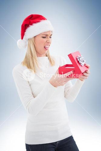 Disappointed blonde opening christmas gift