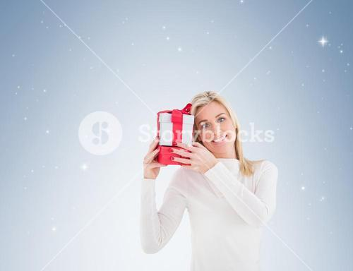 Blonde holding a christmas gift