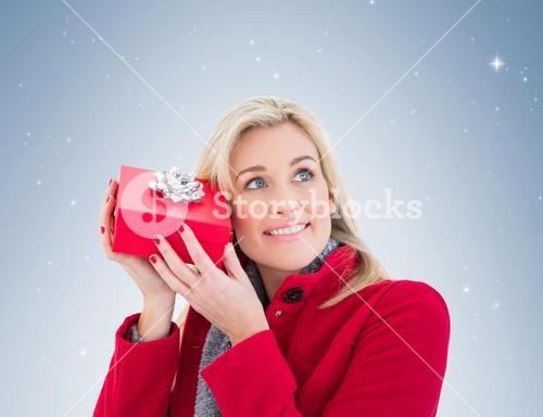 Festive blonde holding red gift