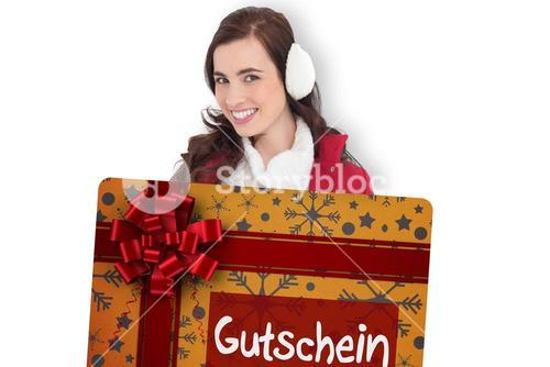 Composite image of beautiful brunette showing gift card