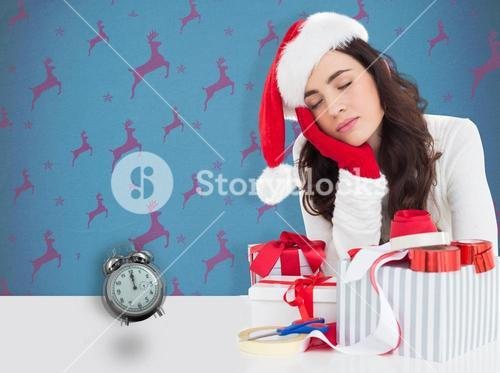 Composite image of brown hair in santa hat napping