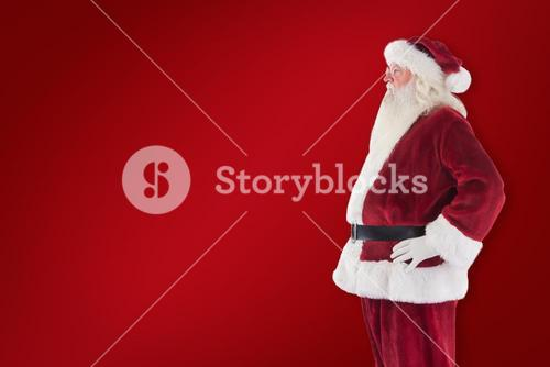 Composite image of santa claus shows his side to camera
