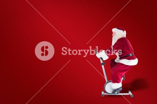 Composite image of santa uses a home trainer