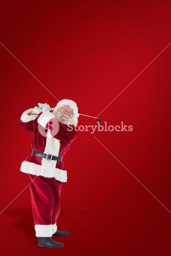 Composite image of santa playing golf
