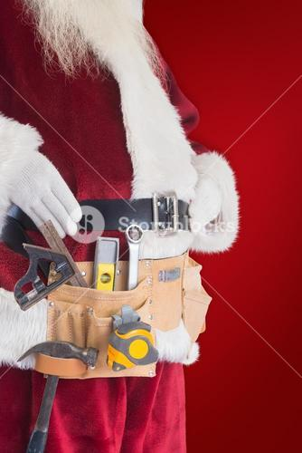 Composite image of father christmas is wearing a tool belt