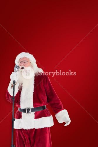 Composite image of santa sings like a superstar