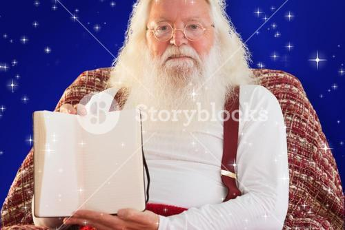 Composite image of father christmas showing a book