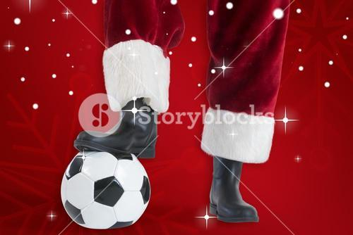 Composite image of santa claus is playing soccer