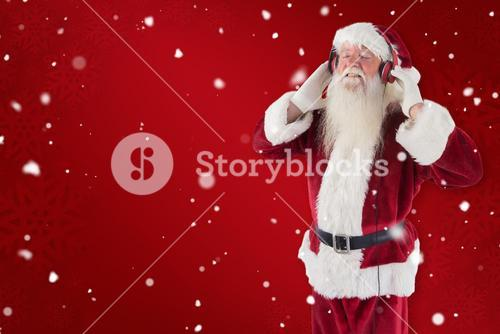Composite image of santa claus enjoys some music