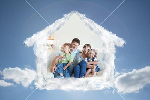 Composite image of smiling family watching tv together