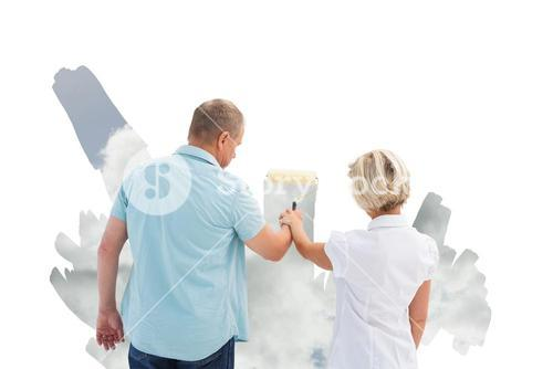 Composite image of happy older couple painting a sky