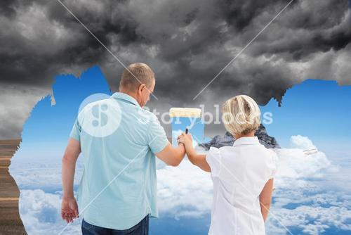 Composite image of happy older couple painting together