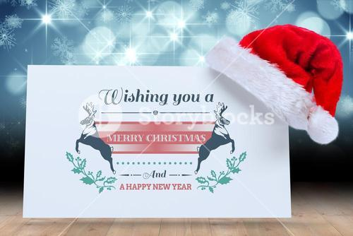 Composite image of colourful banner wishing a happy christmas