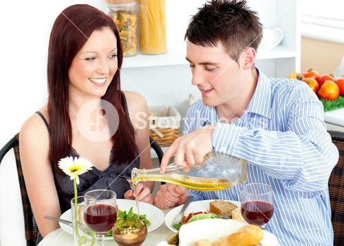 Radiant couple having dinner together in the kitchen
