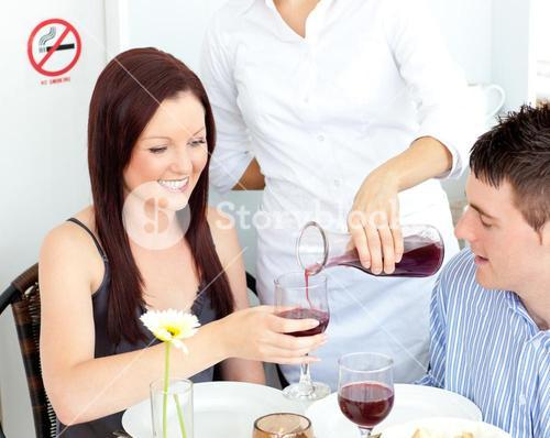 Joyful young couple having dinner at the restaurant