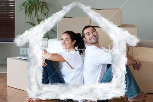 Composite image of bright couple with unpacking boxes moving to a new house