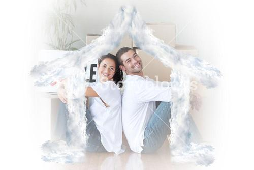 Composite image of happy young couple sitting on the floor