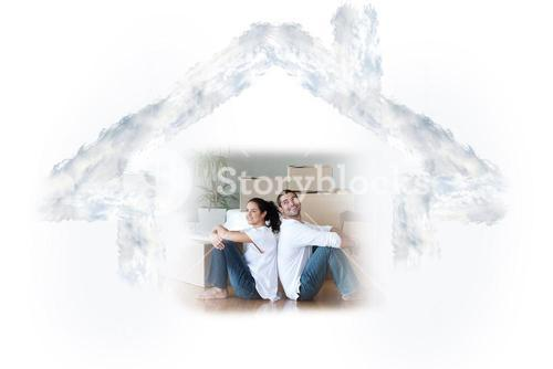Composite image of glowing couple sitting on the floor