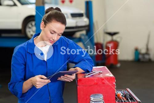 Mechanic using her tablet pc
