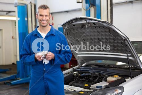 Smiling mechanic looking at camera