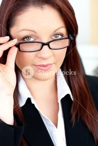 Charismatic businesswoman holding her glasses