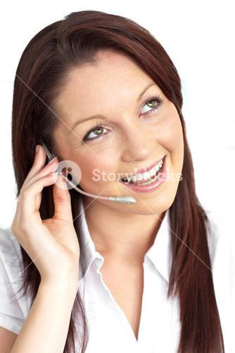 Cheerful young businesswoman with earpiece