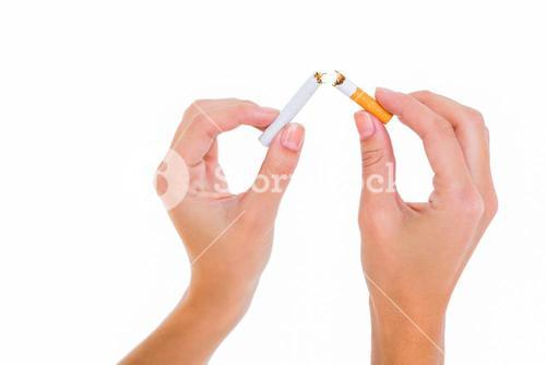 Womans hands snapping a cigarette