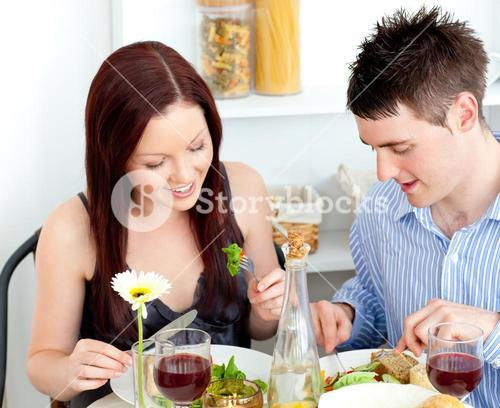 Affectionate couple having dinner at home