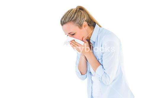 Pretty blonde blowing nose on tissue