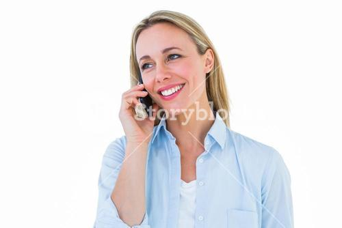 Smiling blonde on the phone standing
